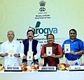 Shripad Yesso Naik releasing the Yoga protocol booklet for the International Yoga Day – 2016, at the inauguration of the National Fair on AYUSH, at Bambolim, in Goa.jpg
