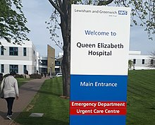 Sign, Queen Elizabeth Hospital, Woolwich (cropped).jpg