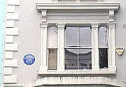 Lancaster's childhood home on Elgin Crescent with a blue plaque
