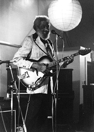 Slim Gaillard - Gaillard with guitar at the Queen's Hall, Edinburgh, Scotland, 1982