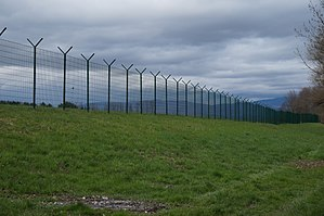 Slovenian border barrier - Border fence at the river Kolpa