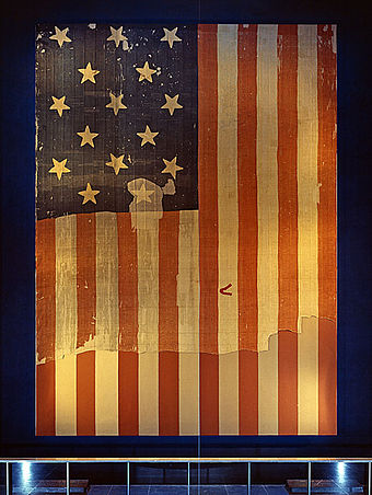 "The 15-star, 15-stripe ""Star-Spangled Banner"" that inspired the poem Star Spangled Banner Flag on display at the Smithsonian's National Museum of History and Technology, around 1964.jpg"
