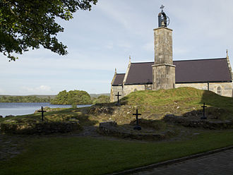 St Patrick's Purgatory - Chapel, bell tower and penitential beds on Station Island. The bell tower stands on a mound that is the site of the original cave.