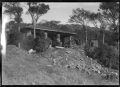 Stone house with pillars at the front of a deep verandah ATLIB 324292.png