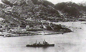 HMS Swiftsure (08) - HMS Swiftsure, entering Victoria Harbour through North Point on 30 August 1945.