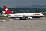 "Swiss International Air Lines McDonnell Douglas MD-11 HB-IWA ""Obwalden"" Qualiflyer ""Blue-Belly"" scheme (24041565434).jpg"