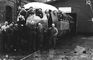 Fábrica Argentina de Locomotoras - Workers with Presidente Peron DMU outside the FAdeL workshop in Liniers (1954).