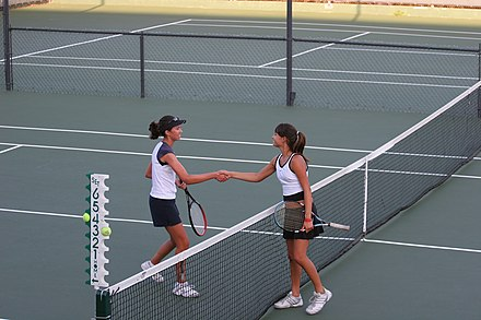 Convention dictates that two players shake hands at the end of a match Tennis shake hands after match.jpg
