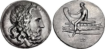 A tetradrachm minted during the reign of Antigonus III Doson (r. 229-221 BC), possibly at Amphipolis, bearing the portrait image of Poseidon on the obverse and on the reverse a scene depicting Apollo sitting on the prow of a ship Tetradrachm, 229-221, Antigonos Doson.jpg