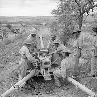 43rd Independent Gurkha Infantry Brigade - Men of the 2nd Battalion, 6th Gurkha Rifles inspect a captured German 75mm anti-tank gun near San Clemente, Italy, 8 September 1944.