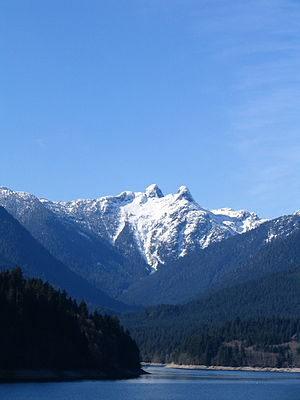 The Lions (peaks) - The Lions seen from Cleveland Dam at Capilano Lake, in the District of North Vancouver