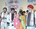The Minister of State for Petroleum and Natural Gas (Independent Charge), Shri Dharmendra Pradhan handing over the LPG connection to a beneficiary, at the launching ceremony of PMUY, at Nazrul Manch, in Kolkata, West Bengal.jpg