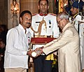 The President, Shri Pranab Mukherjee presenting the Padma Shri Award to Shri Chintakindi Malleshan, at the Civil Investiture Ceremony, at Rashtrapati Bhavan, in New Delhi on April 13, 2017.jpg