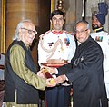 The President, Shri Pranab Mukherjee presenting the Padma Vibhushan Award to Prof. Yash Pal at the Investiture Ceremony at Rashtrapati Bhavan, in New Delhi on April 05, 2013.jpg
