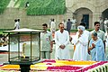 The Prime Minister, Dr. Manmohan Singh and Smt. Gursharan Kaur paying floral tributes at the Samadhi of Mahatma Gandhi at Rajghat in Delhi on October 2, 2004.jpg