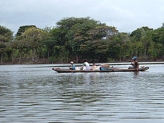 Rupununi - An Amerindian family traveling on the Rupununi River
