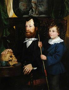 Oil painting of Thomas Bateman seated at a table with right hand on an ancient skull, with his young pre-teen age(?) son William Thomas Bateman standing at his father's left side, holding a thin wooden rod.