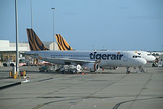 A Tigerair Australia Airbus A320 wearing the new colour scheme at Melbourne Airport in 2014 Tiger Airways Australia (VH-VNR) Airbus A320-232 at Melbourne Airport.jpg