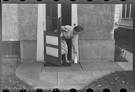 Getting milk at the back door ~ 1940 TotallyFreeImages com-421312-Standard-preview.jpg