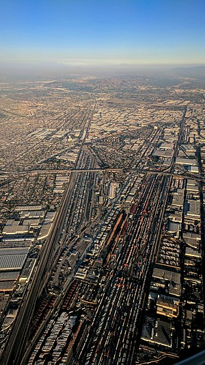 Commerce, California - Late afternoon aerial photograph from the west, of rail yards in Commerce, left, and Vernon, right. The upper center industrial/commercial area is mostly Commerce.