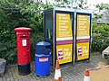 Trilingual phone box ads - geograph.org.uk - 892082.jpg