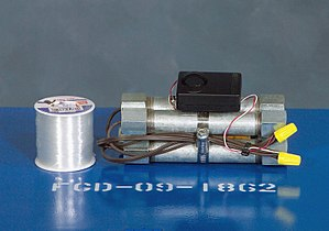 Pipe bomb - A tripwire-triggered pipe bomb mock-up used to train US military service personnel