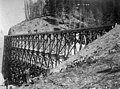Two men standing on a very large Northern Pacific Railway trestle during winter, Washington, ca 1887 (WASTATE 2389).jpeg