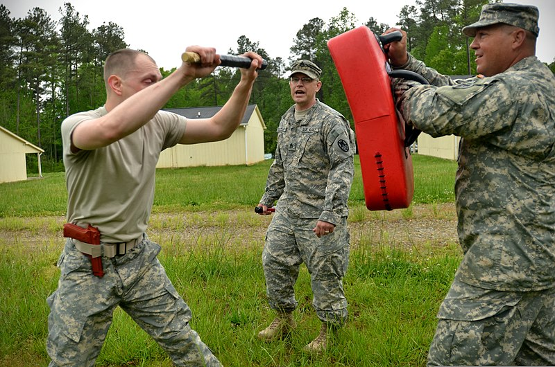 File:U.S. Army Pvt. Jerod Wood, left, with Headquarters and Headquarters Company, 105th Military Police Battalion, North Carolina Army National Guard, makes his way through a defense course during oleoresin capsicum 130501-Z-AY498-004.jpg