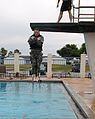 U.S. Army Sgt. Nicholas Peterson, center, a health care specialist assigned to the 5502nd U.S. Army Hospital, jumps off a high-dive platform during the combat water survival event of the Army Reserve Medical 130323-A-HZ691-058.jpg
