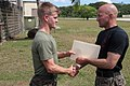 U.S. Marine Corps Capt. Carl M. Tutt, left, accepts his certificate during a graduation ceremony for the Marine Corps Martial Arts Program instructor course at U.S. Naval Computer and Telecommunications Station 130405-M-LN208-066.jpg