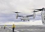 U.S. Navy Aviation Support Equipment Technician 2nd Class Adam Haffner, left, directs a Marine Corps MV-22 Osprey tiltrotor aircraft as it prepares to land aboard the amphibious transport dock ship USS New York 131205-N-YO707-718.jpg