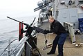 U.S. Navy Gunner's Mate Michael Baglio inspects a .50-caliber machine gun before a live-fire exercise aboard the guided missile destroyer USS Cole (DDG-67) in the Atlantic Ocean Feb. 22, 2014 140222-N-YI411-038.jpg