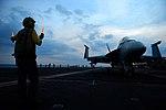 U.S. Navy Petty Officer 2nd Class Stuart Folmar uses lighted wands to direct the pilot of an F-A-18E Super Hornet on the flight deck of the aircraft carrier USS John C. Stennis (CVN 74) during flight operations o 130406-N-TC437-183.jpg