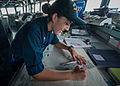 U.S. Navy Quartermaster 3rd Class Larissa Mejia-Castillo plots a course in the pilothouse aboard the guided missile destroyer USS Stockdale (DDG 106) Aug. 13, 2013, in the U.S. 5th Fleet area of responsibility 130813-N-HN991-019.jpg