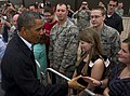 U.S. President Barack Obama, left, greets Airmen and family members at Tinker Air Force Base, Okla., May 26, 2013, en route to surrounding areas damaged by recent tornadoes 130526-F-RH756-454.jpg