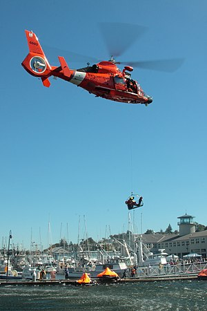Coast Guard Air Station Port Angeles - MH-65C from USCG Air Station Port Angeles performs water rescue demonstration at Fisherman's Memorial event in Seattle, WA. 25-SEP-2010.