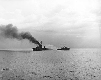 USS Lamson (DD-367) - USS Lamson on fire in Ormoc Bay on 1944-12-07, after she was hit by a kamikaze. The tug assisting with firefighting is probably USS ATR-31.