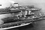USS Langley (CV-1), USS Saratoga (CV-3) and USS Lexington (CV-2) docked at the Puget Sound Naval Shipyard, circa 1930 (NH 95037).jpg