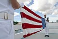 US Navy 020903-N-3228G-002 Sailors assigned to the Ceremonial Guard for Navy Region Hawaii prepare the National Ensign for presentation to family members of Robert Veldron Johnson.jpg