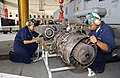 US Navy 021119-N-8029P-003 Aviation Machinist Mates 3rd Class Jeremy Acosta of Helicopter Anti-Submarine Squadron Ten (HS 10), work on a T-700 engine after removing it from a SH-60F Sea hawk.jpg