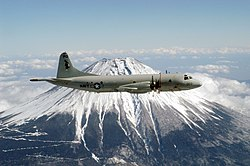 "US Navy 030213-N-9760B-001 A P-3C ""Orion"" assigned to the ""Golden Eagles"" of Patrol Squadron Nine (VP-9) circles Mt. Fuji. VP-9 is forward deployed to Misawa, Japan.jpg"