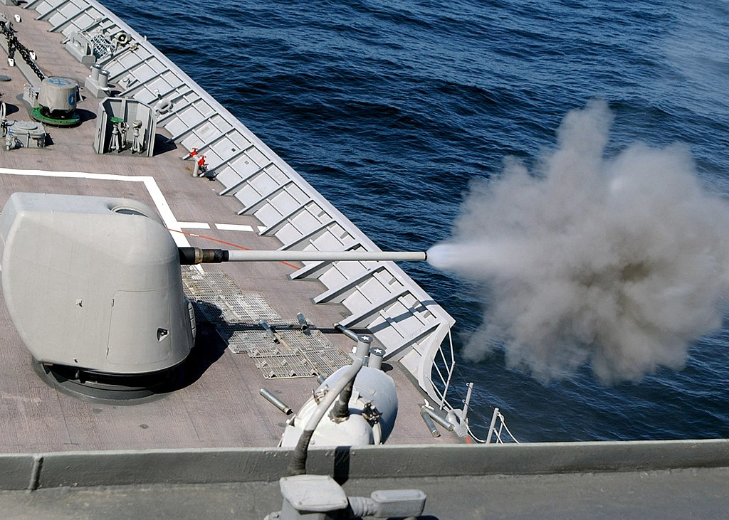 File:US Navy 030609-N-4374S-007 A cloud of propellant-gas discharge is  expelled from the 5-inch gun aboard the aegis cruiser USS Vella Gulf (CG  72).jpg - Wikimedia Commons