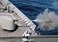 US Navy 030609-N-4374S-007 A cloud of propellant-gas discharge is expelled from the 5-inch gun aboard the aegis cruiser USS Vella Gulf (CG 72).jpg