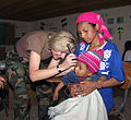 US Navy 030803-N-3031B-008 U.S. Navy Doctor Capt. Cindy Davis examines the inner ear of a child during a free health care clinic conducted at the highlands of Honduras.jpg