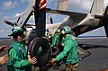 US Navy 031018-N-5821P-006 Storekeeper 3rd Class Jonathan E. Crismond of Camden, N.J., works to off-load cargo from a C-2A Greyhound aboard USS Kitty Hawk (CV 63).jpg