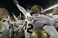 US Navy 031206-N-7676W-073 Naval Academy Junior Pierre Moss celebrates after the singing of the academy Alma Matter.jpg