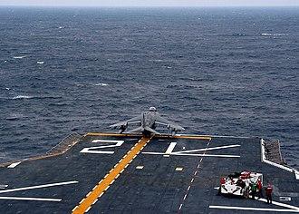 USS Saipan (LHA-2) - An AV-8B Harrier of VMA-223 launches from Saipan in 2004