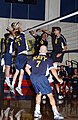 US Navy 040524-F-8156G-001 U.S. Navy Midshipman Sean Burke, far left, and John Mills of Andrews Air Force Base, Md., block Army hitter Dylan Mack, Ft. Lewis, Wash., at the 2004 Armed Forces Volleyball Tournament.jpg