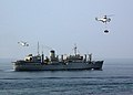 US Navy 041031-N-4374S-002 SA-330 Puma helicopters assigned to the Military Sealift Command (MSC) combat stores ship USNS Saturn (T-AFS 10) transport cargo to the aircraft carrier USS John F. Kennedy (CV 67).jpg