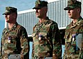 US Navy 041116-N-9712C-005 From left, Master Chief Constructionman Martin Yingling, Chief Equipment Operator Darion Williams and Steelworker 3rd Class Justin Sasser stand at attention wearing Purple Hearts.jpg